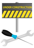 Under construction. Illustration of under construction sign with screwdriver and wrench Royalty Free Stock Photography
