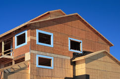 Under Construction. New house is under construction against a blue sky royalty free stock photography