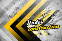 Under construction. A grunge background with yellow and black stripes and text under construction Royalty Free Illustration