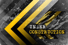 Under construction. A grunge dark background with yellow and black stripes and text under construction Stock Illustration