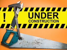 Under construction. Board with construction right tools Stock Photos