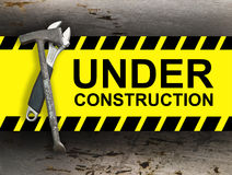 Under construction. Board with construction right tools Royalty Free Stock Image