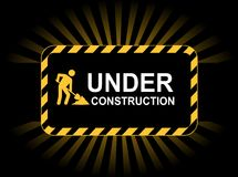 Under construction. A background with yellow and black stripes and the Under construction warning Stock Photos