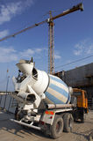 Under construction. Concrete mixer driving in a building site Stock Photos
