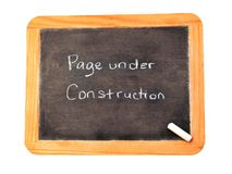 Under Construction. Chalkboard with Page under construction written on it royalty free stock photos