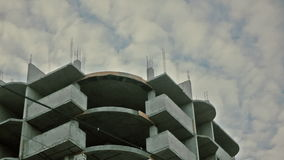 Under construction apartments. Concrete house on a background of clouds stock video footage