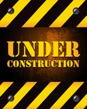 Under construction background. An under construction background sign with alert warning inform and words. Coming soon Royalty Free Stock Photos