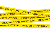 Under construction background. With yellow ribbons Stock Photo
