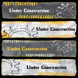 Under Construction Banners. With various grungy design elements on dark background Stock Image