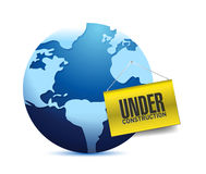 Under construction barrier and earth globe Royalty Free Stock Photos