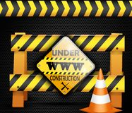 Under construction barrier over black background Royalty Free Stock Photos