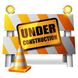 Under construction barrier. Under construction barrier, warning sign and traffic cone Royalty Free Stock Photography