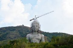 Under construction Buddha on the mountain Royalty Free Stock Image