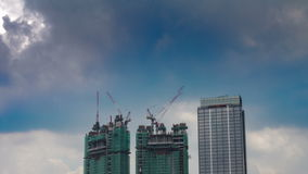 Under construction 2 buildings time lapse stock footage