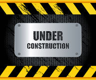 Under construction button. Under construction sign on black background Stock Photography