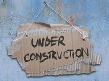 Under construction Cardboard sign on a rope. Royalty Free Stock Photos