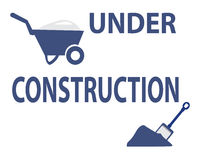 Under construction with cart and shovel sign Royalty Free Stock Photography