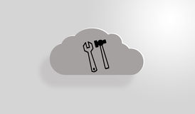 ''Under Construction'' Cloud. Grey cloud with a small white shine from the back and another one from the upper left.Two tools sign at first sight Royalty Free Stock Photo