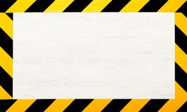 Under construction concept background. Warning tape. Under construction concept background. Warning tape frame on white wooden surface background with copy stock images
