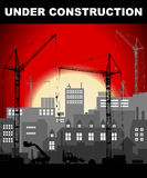 Under construction concept in industrial European vintage styled city under construction on bright red sunset Royalty Free Stock Photography
