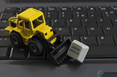 Under construction. Concept with toy and keyboard Stock Photography