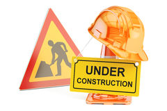 Under construction concept. Traffic cones, hardhat and road sign Royalty Free Stock Image