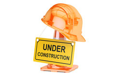 Under construction concept. Traffic cones, hardhat and roadsign Royalty Free Stock Images