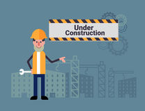 Under construction concept vector illustration. Cartoon young man with engineering tool standing infront of building and under construction sign Royalty Free Stock Images