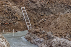 Under construction, construction site foundation. With ladder. Selective focus Stock Photo