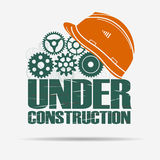 Under construction, gears and helmet Stock Photography