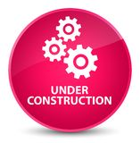 Under construction (gears icon) elegant pink round button Royalty Free Stock Photos