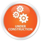 Under construction (gears icon) premium orange round button Royalty Free Stock Photography