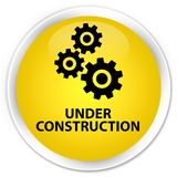 Under construction (gears icon) premium yellow round button Stock Photography