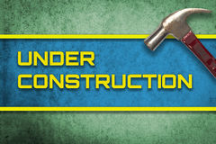 Under Construction green banner with hammer Stock Image