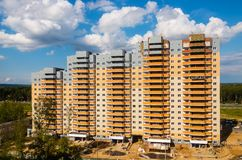 Under construction high-rise building on the background of highw Royalty Free Stock Image