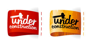 Under construction labels. Stock Images