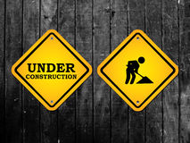 Under construction men working yellow sign Royalty Free Stock Photo
