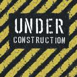 Under construction message on asphalt background Stock Photo