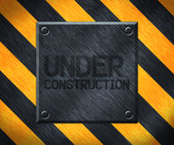 Under Construction Metal Plate Background Royalty Free Stock Photos