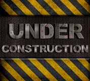 Under construction metal text Royalty Free Stock Photo