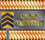 Under construction metal text with rivets over grid Royalty Free Stock Images