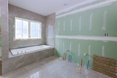 Free Under Construction New Bathtub Remodeling A Home Bathroom, Plumbing Pipe For New Sinks Stock Photo - 191684260