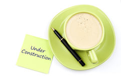 Under construction note and coffee Royalty Free Stock Photography