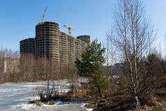 Under construction residential house. On river bank in Saint-Petersburg suburb, Russia Stock Photos