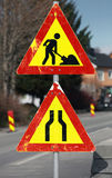 Under construction and Road narrows signs Royalty Free Stock Photo
