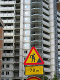 Under construction road sign on building Stock Image