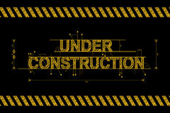 Under construction road sign in yellow on black Stock Images