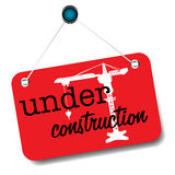 Under construction sign. Red sign with crane and the text under construction written with black letters Royalty Free Stock Photo