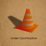Under construction sign. On grunge recycled paper board Royalty Free Stock Photo