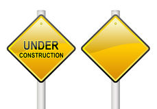 Under construction sign. A under construction sign and a blank sign post Stock Photo